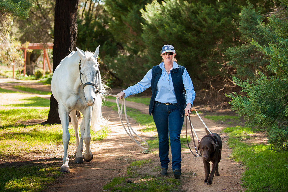 Sue-Ellen with her horse and her Guide Dog
